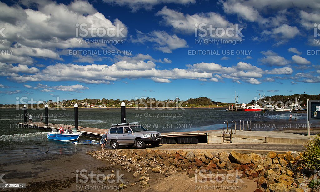 Launching a small fishing boat from a trailer stock photo