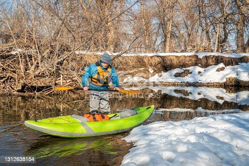 istock launching inflatable whitewater kayak 1312638154