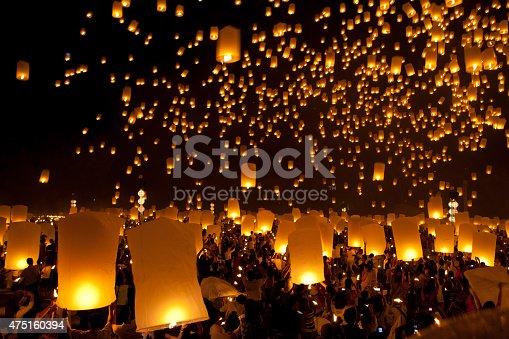 istock launching sky lanterns in Loy Krathong  Festival 475160394