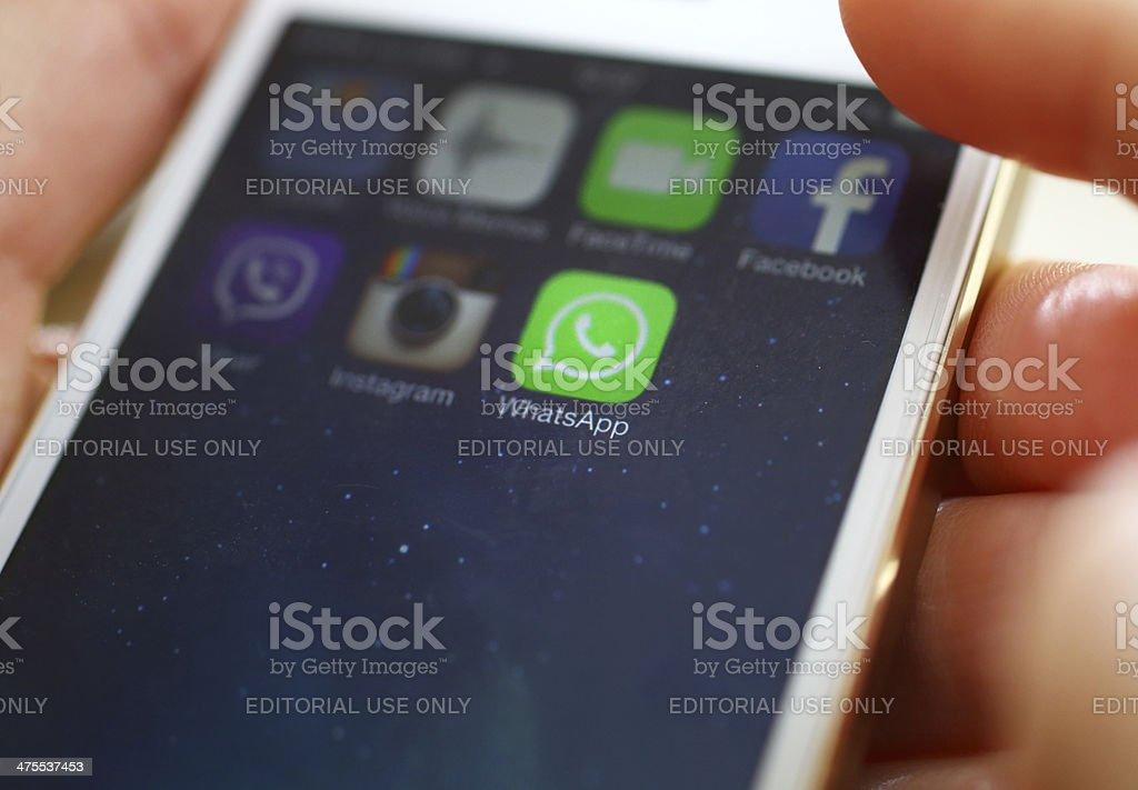 Launching WhatsApp on iPhone 5s. stock photo