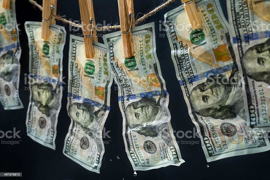 Laundered dollars hanging on a rope stock photo