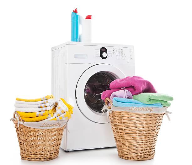 Laundry basket and washing machine Laundry basket with colorful towel and washing machine over white background laundry basket stock pictures, royalty-free photos & images