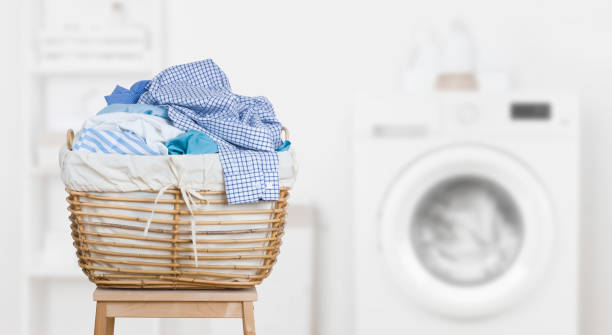Laundry basket on blurred background of modern washing machine stock photo