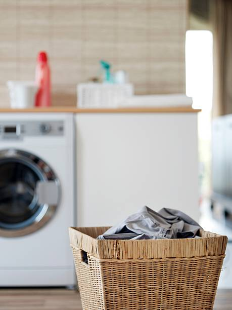 laundry basket - laundry laundry room stock photos and pictures