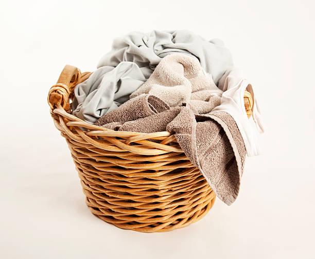 laundry basket A basket of washing laundry basket stock pictures, royalty-free photos & images