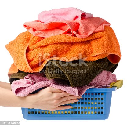 460589747istockphoto Laundry Basket with colorful towel in hands 924813890