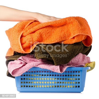 460589747istockphoto Laundry Basket with colorful towel in hands 924813902