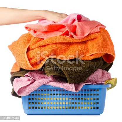 460589747istockphoto Laundry Basket with colorful towel in hands 924813944