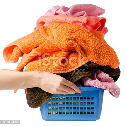 460589747istockphoto Laundry Basket with colorful towel in hands 924813964