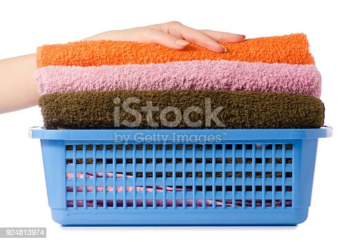 460589747 istock photo Laundry Basket with colorful towel in hands 924813974