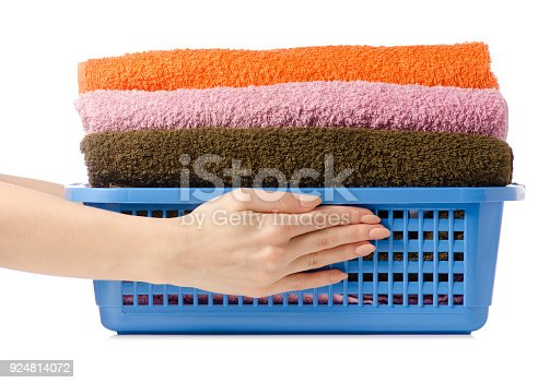 460589747istockphoto Laundry Basket with colorful towel in hands 924814072