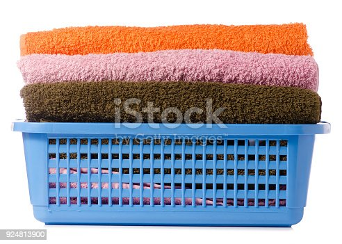 460589747istockphoto Laundry Basket with colorful towel 924813900