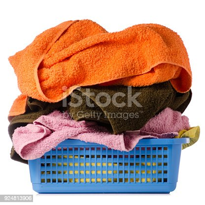 460589747istockphoto Laundry Basket with colorful towel 924813906
