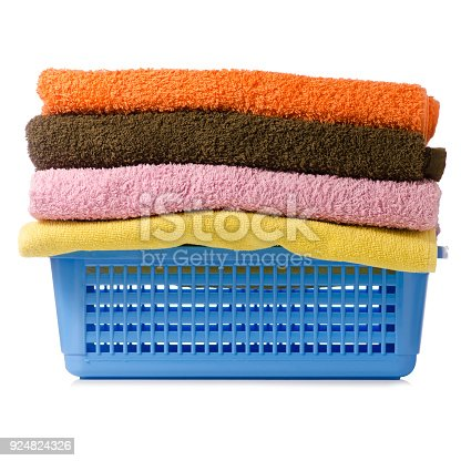 460589747istockphoto Laundry Basket with colorful towel 924824326