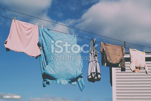 Laundry clothes line on a sunny day. Faded look.