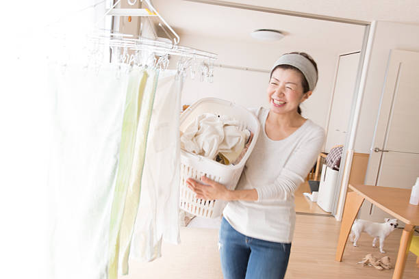 laundry clothes - stay at home parent stock pictures, royalty-free photos & images