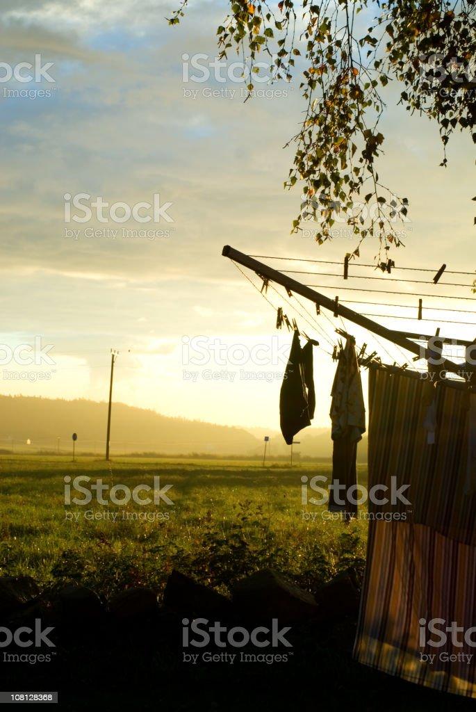 Laundry Drying on Clothesline at Sunrise royalty-free stock photo