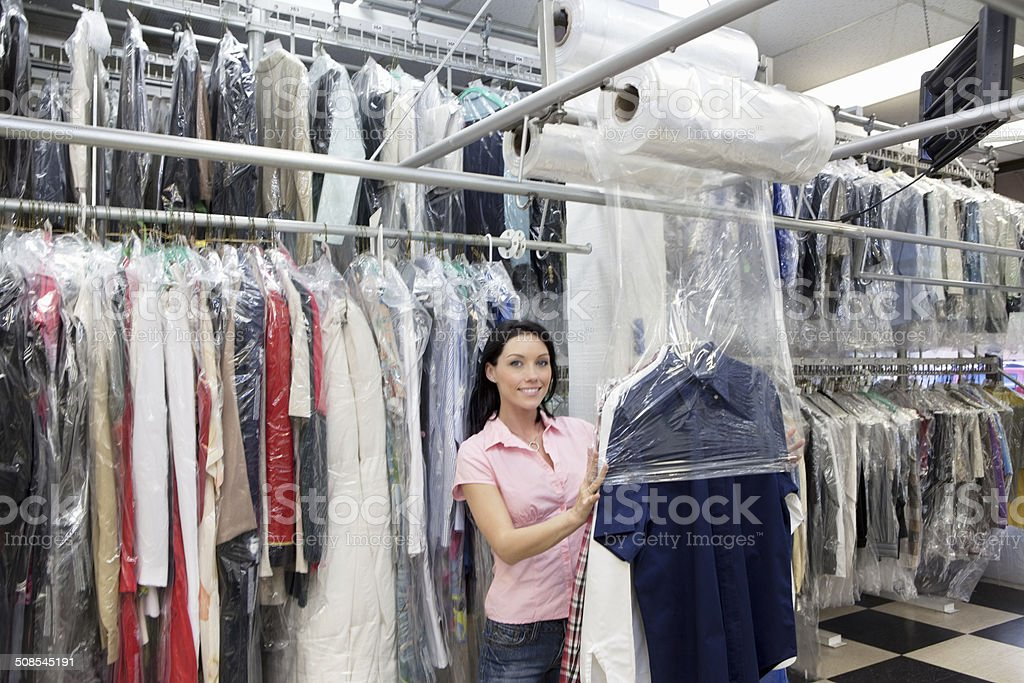 Laundry employee working stock photo