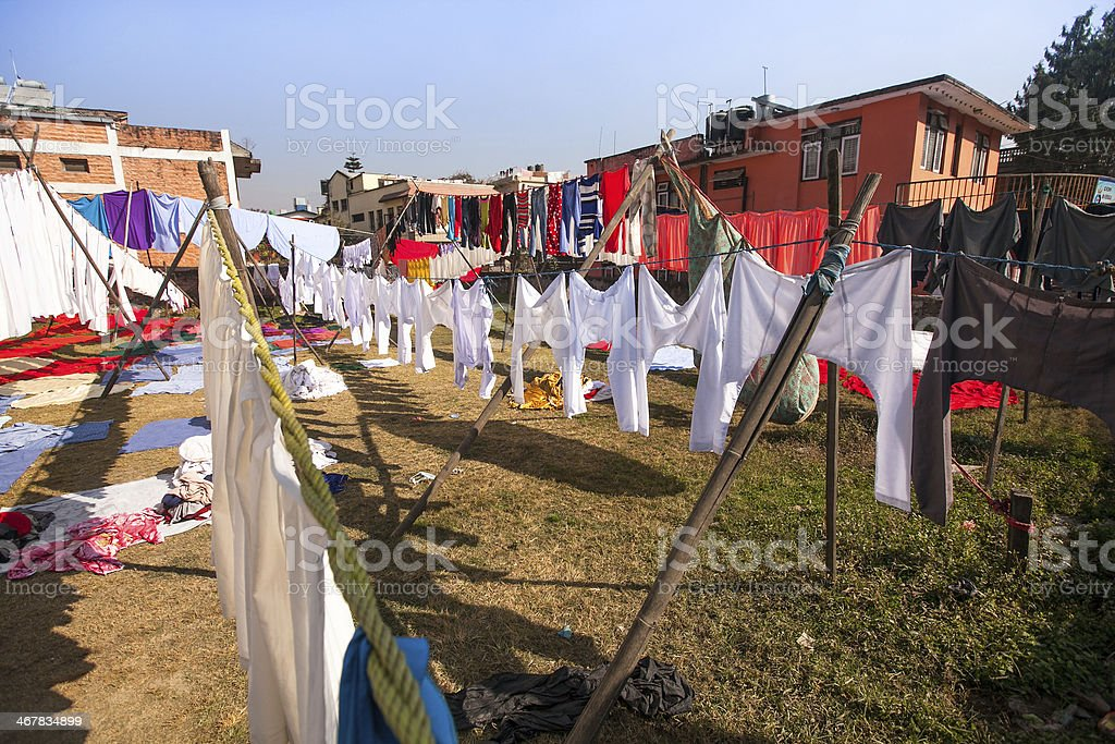Laundry hanging in the open to dry stock photo