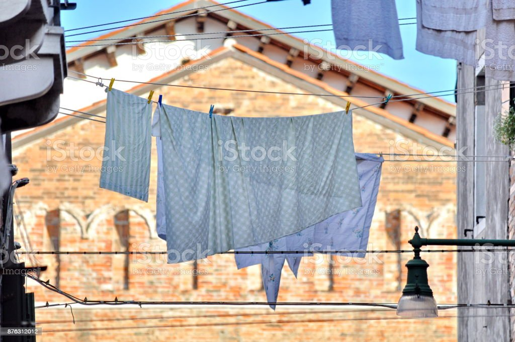 Laundry hanging out on a clotheslines in Venice, Italy. stock photo