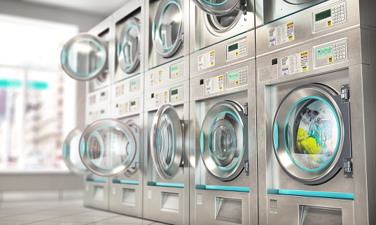 Laundry. Industrial washing machines in the laundry. 3d illustration