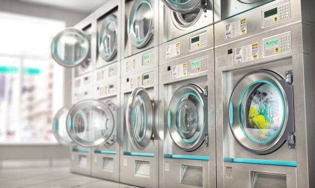 Laundry. Industrial washing machines in the laundry. 3d illustration stock photo