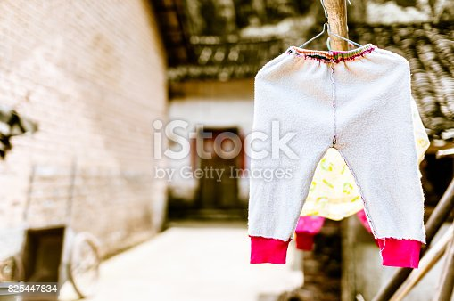 istock laundry of children on clothesline in China 825447834