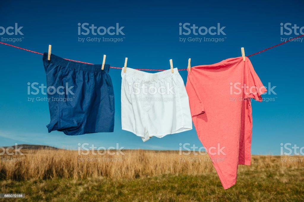 Laundry on a washing line. stock photo