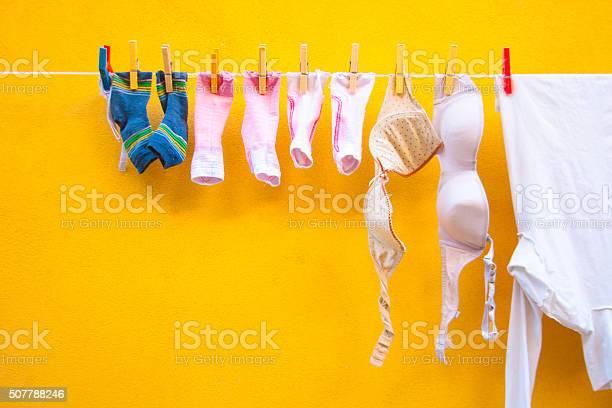Laundry on line vibrant yellow wall italy picture id507788246?b=1&k=6&m=507788246&s=612x612&h=m kqdq2cvlcy74sdl16a1lcz7dp4vwebgctkcqmi 2c=