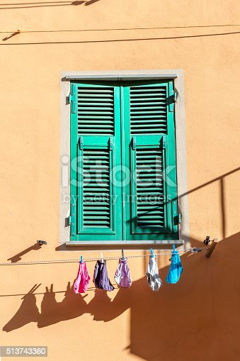 Laundry on the line under the sun in Italy. Shot in Riomaggiore, via Colombo, Italy
