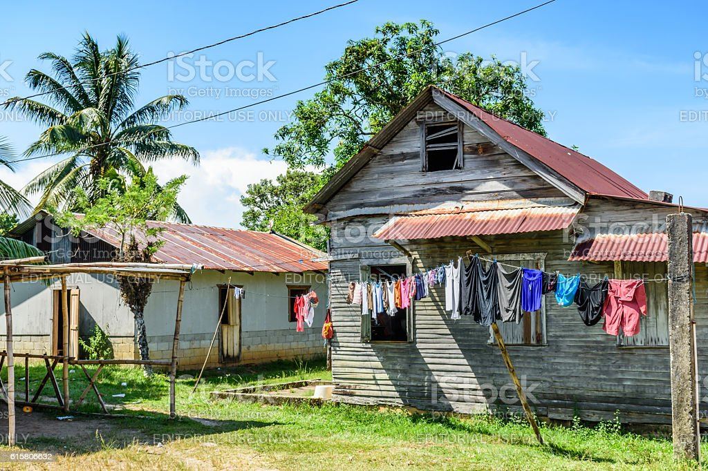 Laundry outside wooden house in Caribbean town stock photo