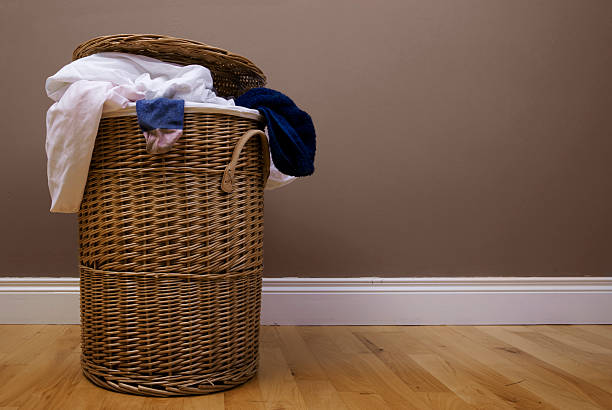 laundry laundry basket with dark background laundry basket stock pictures, royalty-free photos & images