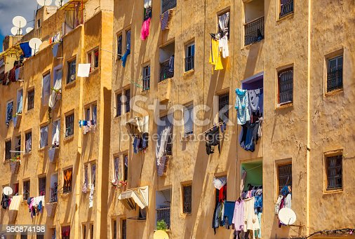 buildings with windows full of hanging and drying clothes in the medina of Fez, Morocco