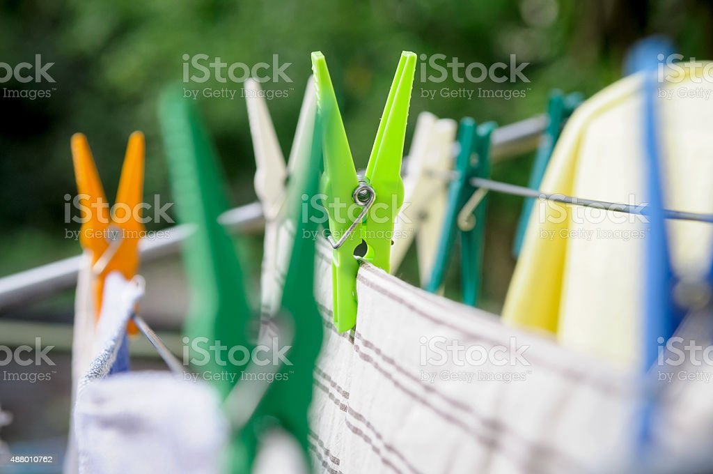 laundry pins and hanged clothes stock photo