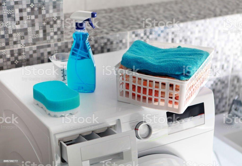 laundry powder on washing machine stock photo
