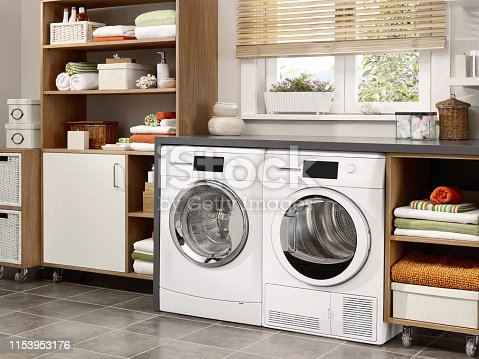 Domestic laundry room with washing machine and dryer