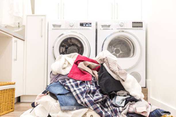 laundry room with a pile of dirty clothes - laundry laundry room stock pictures, royalty-free photos & images