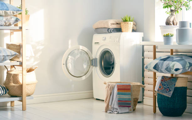 laundry room with a washing machine stock photo