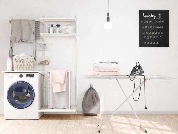 laundry room with washer, iron, iron board - laundry laundry room stock pictures, royalty-free photos & images