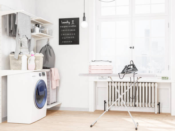 laundry room with washing machine and iron - laundry laundry room stock pictures, royalty-free photos & images