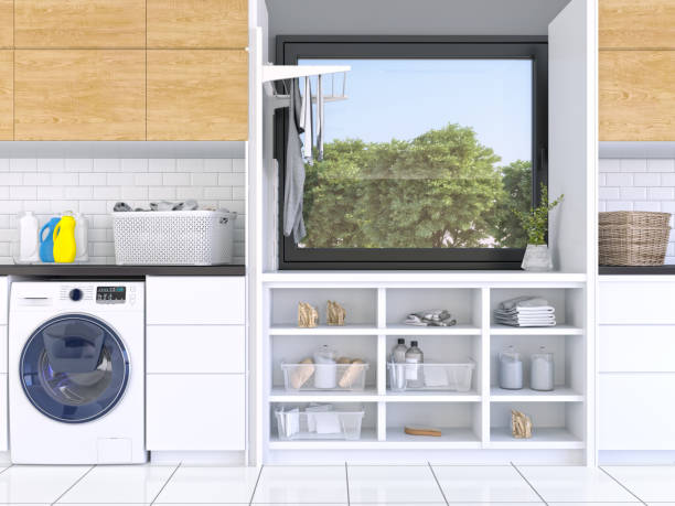 laundry room with white cabinets - laundry laundry room stock pictures, royalty-free photos & images