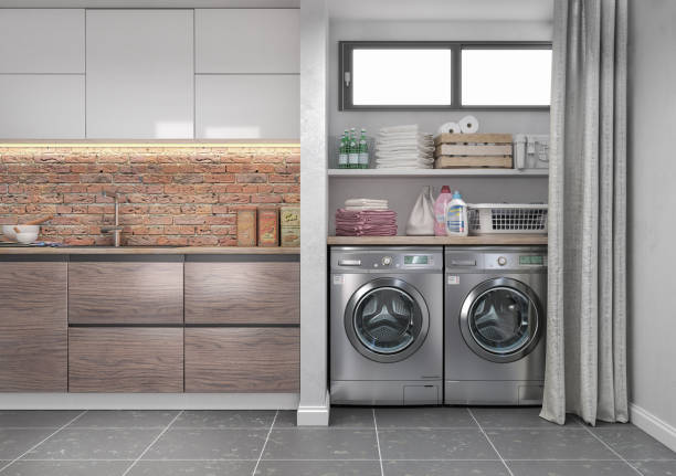 Laundry room with wood floor, washing machine at closet,grey wall, shelving and clothes. 3d illustration stock photo