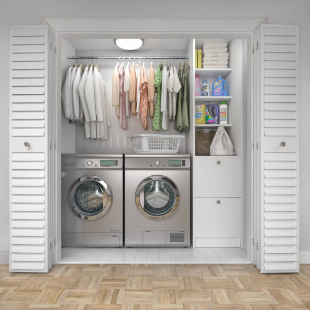 Laundry room with wood floor, washing machine at closet,white wall, shelving and clothes. 3d illustration stock photo