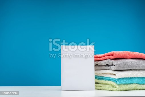 1146468307 istock photo Laundry table with detergents and clean linens 990557240