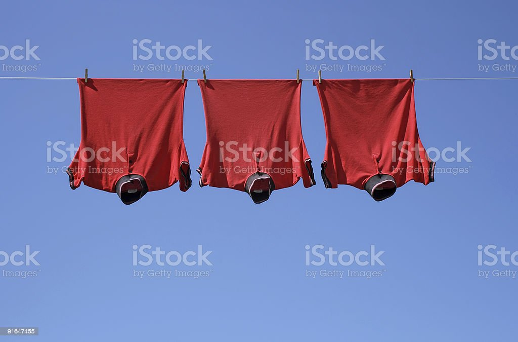 Laundry, three red t-shirts royalty-free stock photo