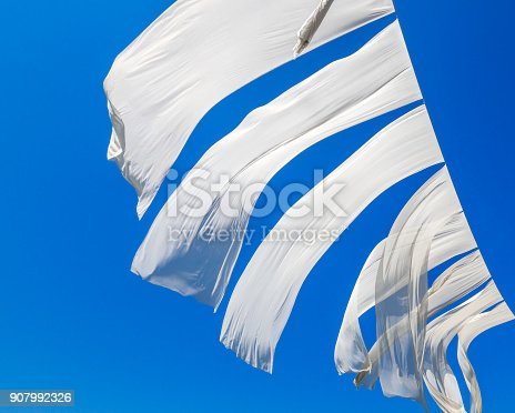 istock Laundry, White sheets  hanging on clotheslines 907992326