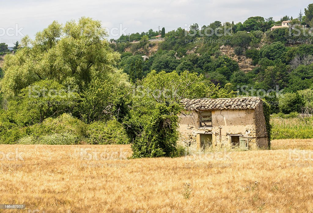 Lauris (Vaucluse, Provence) and isolated ruin royalty-free stock photo