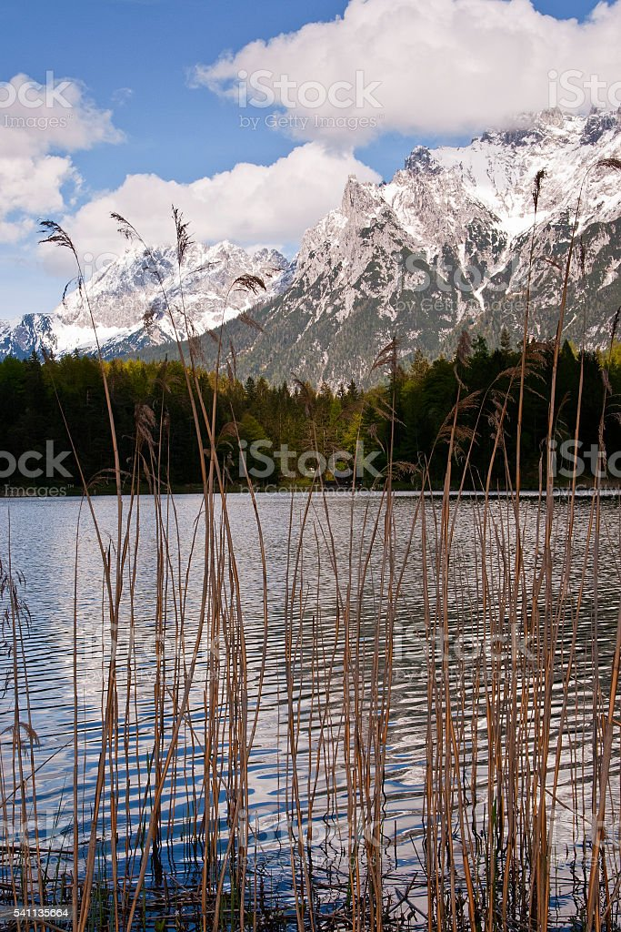 Lautersee lake and snowy Karwendel mountain range at Mittenwald stock photo