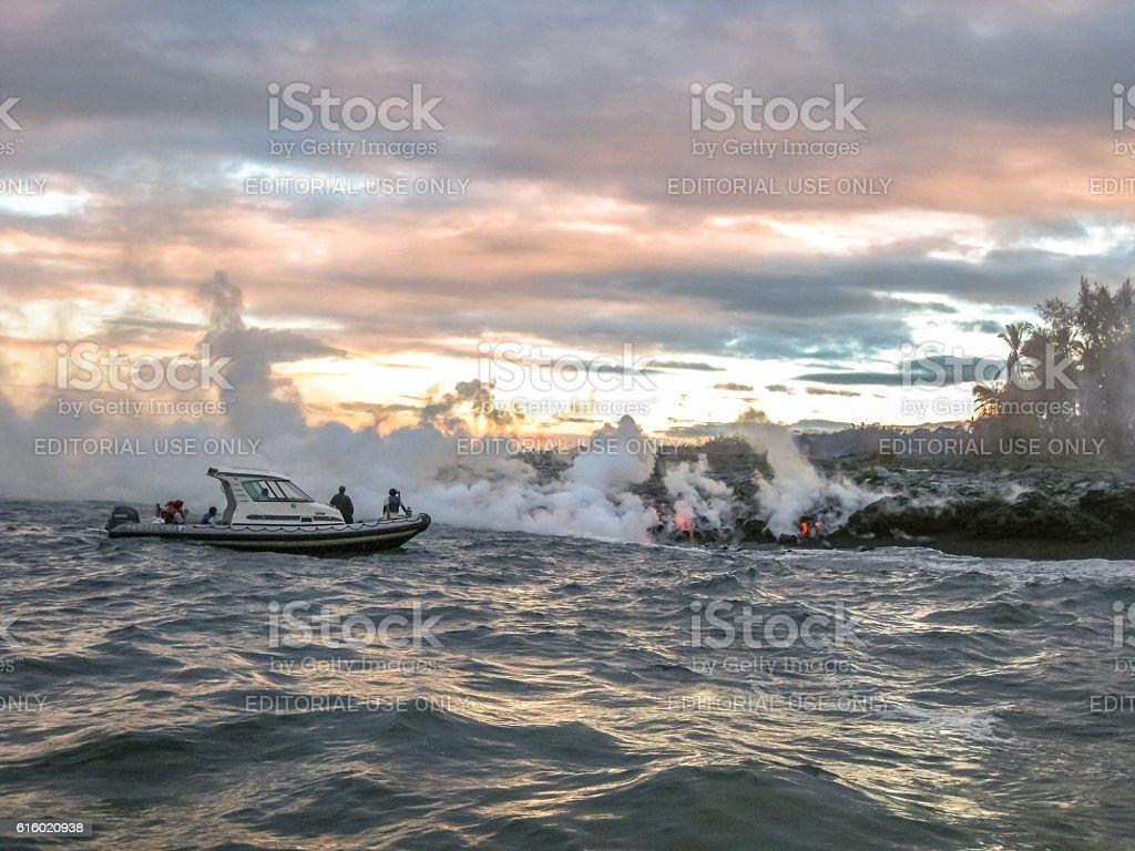 Lava boat tour Hawaii stock photo