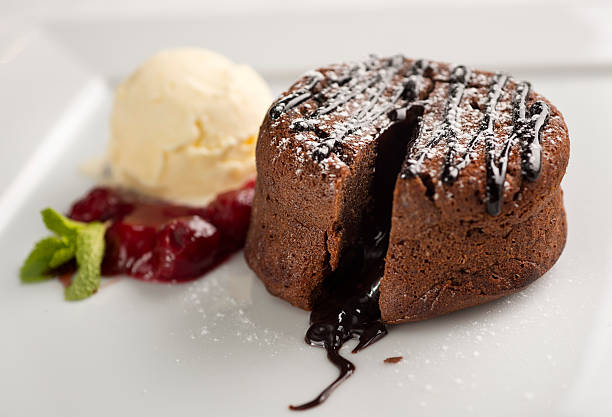 Lava cake with ice cream and mint leaves stock photo